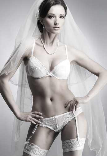 Black and white photo of young beautiful bride in sexy bridal li